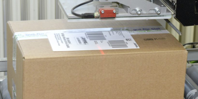 A cardboard box being labeled